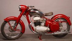 JAWA 500 OHC motorcycle - 1952  • 4-stroke air-cooled OHC twin cylinder.   • Engine power 19.1 kW at 5500 rpm.   • Compression ratio 7 to 1  • Vertical shaft camshaft drive.   • Lubrication by three-way pump.   • 4-speed gearbox in unit with engine.  • Multi-plate clutch in oil bath  • Square steel sections frame  • Slider type rear wheel suspension.   • Telescopic front fork.  • Weight 156 kg.  • Max speed 135 km/hour  • Average fuel consumption 3.5 to 4 ltr/100 km