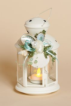 8 inchH White Lantern with Natural Shells, Aqua Bow and Battery Tea Li | Harvest of Barnstable