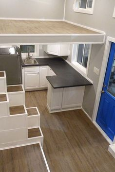 Two large bedroom lofts with storage stairs leading to each loft. The kitchen has a full refrigerator and a peninsula.