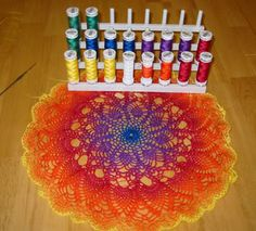 "Wovenflame: August 2004 -""painted"" thread crochet technique using three strands of sewing thread held together, with gradual color changes in each round. Popular in the West Indies"