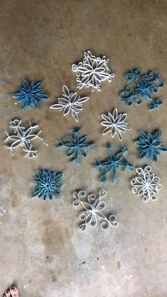 DIY Snowflakes (Frozen theme party)    Made from toilet and paper towel rolls.  DIRECTIONS: Fold roll flat and measure with marker 1/2 inch cuts. Design how you want them to look. Hot glue pieces together and then spray paint designed snowflake. Use Elmers glue to cover areas of the flake you want to glitter! This is time consuming but fun!