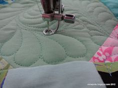 Free motion quilting - feathers