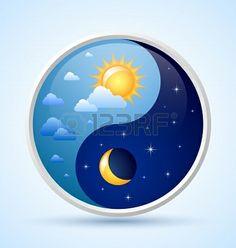 Día y noche, yin yang símbolo en fondo azul claro photo