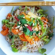 Fresh Asian Noodle Bowl! Brown rice noodles, tons of fresh veggies and an incredible and flavorful sauce! So easy to make! #glutenfree #asian #noodles