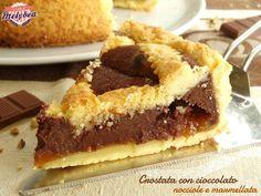 Crostata con cioccolato nocciole e marmellata