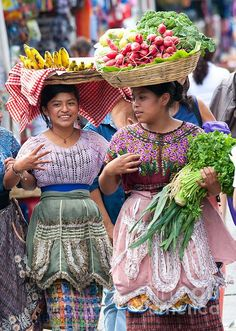 Colorful close-up portraits of ethnic Mayan women fruit sellers wearing local costume in Antigua, Guatemala, Central America