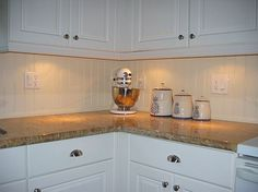 i love the wainscoting used as a backsplash. #kitchen #wainscoting