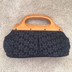 Black Jcrew crocheted clutch Beautiful and barely used black Jcrew clutch for sale. Crocheted stitching on all sides (including bottom) with wooden handles and a magnetic snap closure. Great clutch that is big enough to fit all your essentials. J. Crew Bags Clutches & Wristlets
