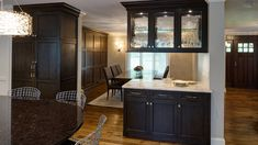 Drury Design Oak Brook Illinois transitional home remodel. Dark Grabill cabinetry in Mystic, granite island countertops, perimeter countertops in Quartzite.