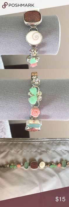 Blush Druzy bracelet with aqua marine This is a one of a kind bracelet made specifically for an outfit I no longer wear. This has some real pieces of gemstone, druzy and shell. Beads by Brenda Jewelry Bracelets