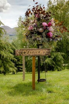Ceremony sign captures the beauty of flowers by Crimson wedding flowers