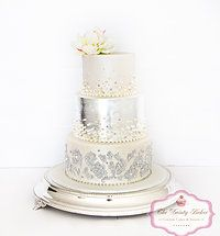 3 tiered wedding cake with silver leaf and individually placed pearls www.thedaintybaker.com
