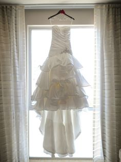 So pretty! Good photo opp for the wedding dress on a personalized hanger!