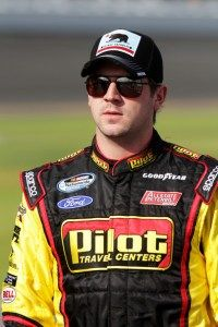 Michael Annett, driver of the #43 Pilot Ford, walks on the grid during qualifying for the NASCAR Nationwide Series DRIVE4COPD 300 at Daytona International Speedway on February 22, 2013  Photo -  Jerry Markland/Getty Images  http://fan4racing.com/2013/03/02/annett-recovering-from-injury-suffered-at-daytona/#