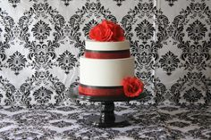 Red and black damask theme with our wedding cake stand!