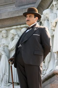 Hercule Poirot as played by David Suchet - he does such an amazing job of bringing the character to life.