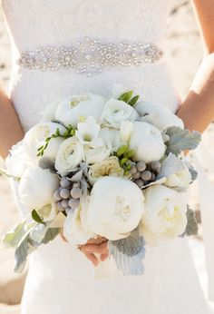 All-white bouquet with dusty miller & silver brunia: http://www.stylemepretty.com/collection/2154/