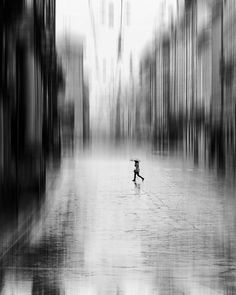 Alone in the rain Photo by Trefla Cata -- National Geographic Your Shot