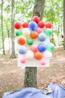 diy splatter painting with darts and balloons