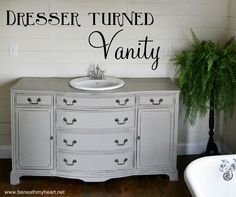 this is almost the identical vanity and colour to the one we put in our main bathroom!!  Benjamin Moore Stonnington Gray in our case. I think this one was done in Annie Sloan chalk paint.