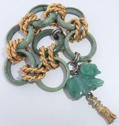 Vintage William Delillo carved jade and aventurine ram bracelet (via urbantiques)