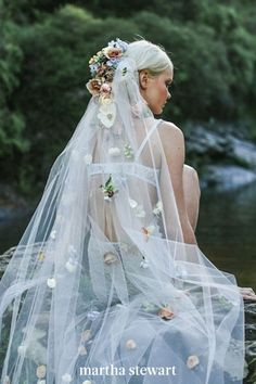Want to keep your look traditional for your ceremony, but love the idea of an unexpected veil? Wear an unexpected iteration for another part of your big day—your boudoir shoot. Jardine Hansen pinned fresh flowers down this trailing headpiece for this bride's solo photoshoot. #weddingideas #wedding #marthstewartwedding #weddingplanning #weddingchecklist Bridal Boudoir Photos, Wedding Boudoir, Wedding Veils, Wedding Makeup, Wedding Hair, Vail Wedding, Bridal Veils, Bridal Shoot, Boho Wedding