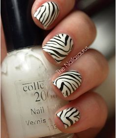 Zebra nails look awesome when done properly, with precision. You can do this by painting your nails white & adding black crooked lines on it, that taper to a fine point.