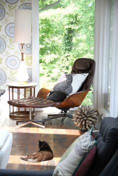 Rustic floors + graphic wallpaper + modern molded chair. I'm obsessed with that amy butler wallpaper!