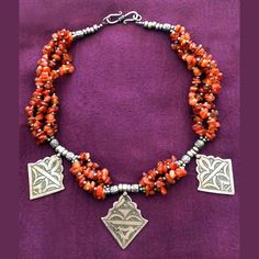 Original Ethnic Necklace with Hand-carved Sterling Silver pieces and Agata. Made by the Desert Amazigh People from Souther Morocco.  This Choker style necklace measures 41cm / 16.2in of length. The sterling silver pieces measure 3x4cm / 1,2x1.5cm.  Made in Morocco with love.