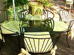 Pier 1 patio set - I love the chairs two with their yellow daisy bistro table would work nicely on my porch.