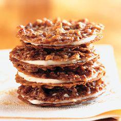 Pecan Lace Sandwich Cookies with Orange Buttercream Recipe: Bon Appétit Köstliche Desserts, Delicious Desserts, Dessert Recipes, Yummy Food, Plated Desserts, Orange Buttercream, Buttercream Recipe, Buttercream Filling, Lace Cookies Recipe