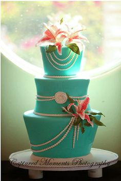 Turquoise stargazer lily cake - great modern shapes