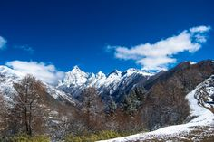 Practical information and beautiful photos to introduce trekking in Siguniang Shan (Four Sisters Mountain) in Sichuan province, China.