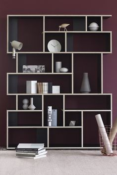 This customized wall storage in black from Tylko looks awesome against a plum wall. #wallstorage #custom #storage