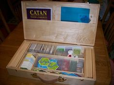Custom Catan wood box...to hold ALL expansions!  Too bad it isn't even for sale.  Anyone know a wood craftsman/woman?