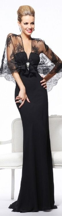 Black lace capelet with rhinestone embellishment over floor length black evening gown. Timeless.