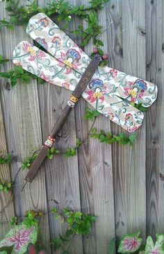 "Fence Art.  Ceiling fan blade and table leg dragonfly.  ""Tootsie"" by Bless Your Heart Art ... kathryncrews@comcast.net"