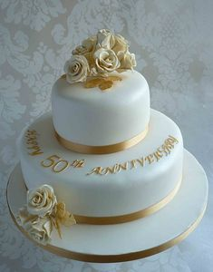Two Tier Golden Anniversary Wedding Cake Design. Two Tier Golden Anniversary Wedding Cake Design.