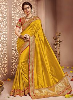 Buy Yellow Art Sanchi Silk Saree online from the wide collection of sari.  This Yellow colored sari in Art Silk fabric goes well with any occasion. Shop online Designer sari from cbazaar at the lowest price.