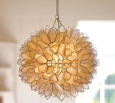 Pottery Barn Capiz Pendant     Capiz-shell light fixtures are a growing trend in home decor. And why not? The shells bloom luminescent when lit from within, giving off a soft, elegant glow and the the price tags on these chandeliers and wall sconces are a fraction of what you'd pay for anything done in glass or crystal. The Pottery Barn Capiz Pendant ($199) is our current love; we just can't get over the gorgeousness of the lotus design.