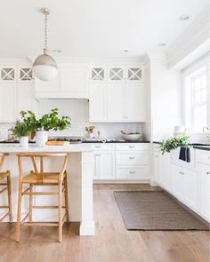 Top Pins of the Week - Studio McGee white farmhouse kitchen with wishbone stools