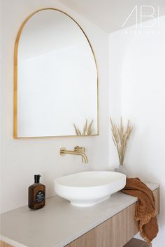 The bathroom inside @luca_onthebeach sets the tone for a bright and serene holiday in Maroochydore.   Our brushed brass tapware brings warmth into the Airbnb, while the coastal style is a welcoming presence after a long day at the beach.  📸 by @villastyling   🛒 ABI Featured Products - Elysian Minimal Mixer and Spout Set Coastal Bathrooms, Boho Bathroom, Bathroom Styling, Bathroom Goals, Bathroom Ideas, Minimalist Bathroom Design, Bathroom Interior Design, Interior Decorating, Bathroom Tapware