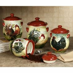"Le Rooster Kitchen Canister Set is made of colorful handpainted earthenware with a glaze finish. Whimsical canisters have different roosters on each piece to add a touch of fun to your kitchen or dining room. Canisters are 6""-7.5"" dia. and 9""-11""H. Set weighs approx. 12 lbs. Food safe. Hand wash.• Four-piece rooster kitchen canister set (one of each size)• Designed by (C)Susan Winget• Has airtight lids to help keep items fresh• Great with rooster-themed decor"
