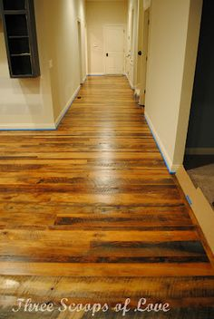 gorgeous reclaimed barn wood floor...the whole house...top to bottom...area rungs everywhere!