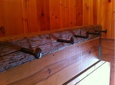 Beautiful coat rack.  Made with an old barn beam and railroad spikes.