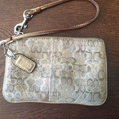 Coach wristlet Gently used. Some marks on the inside from use. So cute and goes with everything! Coach Bags Clutches & Wristlets
