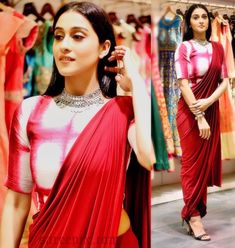 Actress Regina Cassandra in dhoti saree at a charity event. She looks eye catchy in saree with high neck blouse.