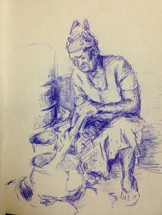 Burkinese vrouw kookt op traditionele manier sorgum. November 2014