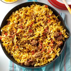 Chili Beef Noodle Skillet Recipe -A friend gave me this recipe. My husband likes this entree's hearty blend of beef, onion and tomatoes. I like it because I can get it to the table so quickly. —Deborah Elliott, Ridge Spring, South Carolina