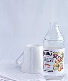 Remove stubborn price tags or stickers. Paint them with several coats of vinegar, let the liquid soak in for five minutes, then wipe away the residue.     Kill weeds between cracks in paving stones and sidewalks. Fill a spray bottle with straight vinegar and spray multiple times. (Be careful not to get any on the surrounding grass, as it will kill that too.)